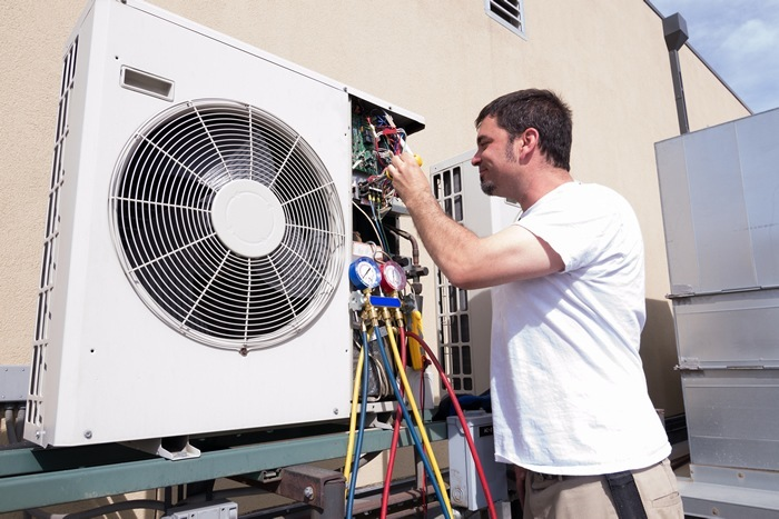 Contractor working on a Commercial HVAC unit