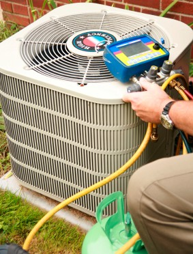 HVAC Contractor working on an AC Unit tune-up